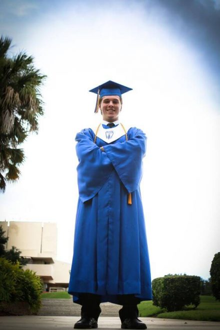 Account Control Technologies inc - boy in a blue graduation gown and cap