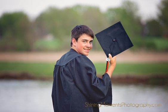 CBE Group Inc - man wearing a graduation gown and holding his cap