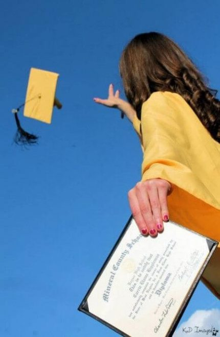 Enterprise Recovery Systems Inc - a girl trowing her graduation gown up