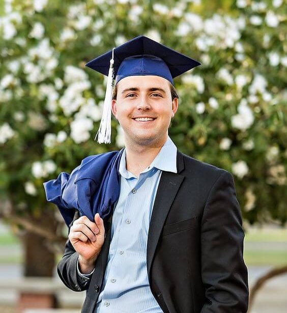 GC Services - smiling man in a graduation cap