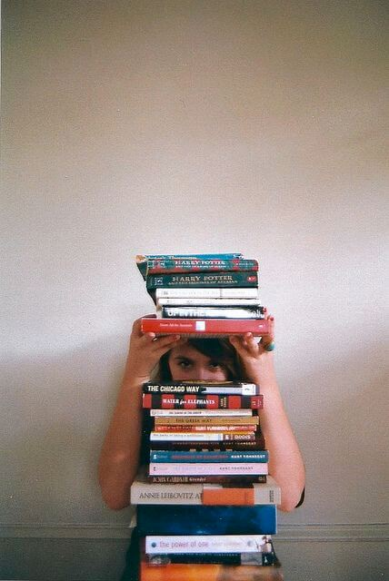 Immediate Credit Recovery Inc - lady looking over a pile of books