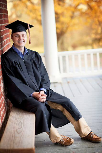 New York Higher Education Loan Program - a man wearing a graduation gown