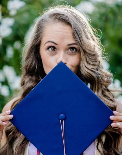 Cedar Financial - girl covering her face with a graduation cap